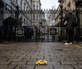 Greenpeace UK activists drove remote-control electric toy cars under the security gates of Downing Street and down towards Number 10 in a demonstration urging the UK Prime Minister to back a 2030 ban on new petrol, diesel and hybrid vehicles.