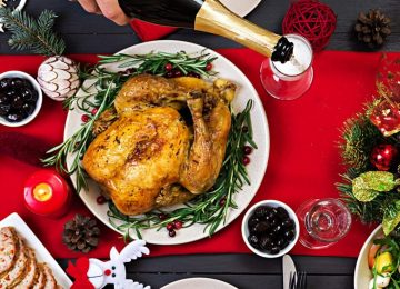 baked-turkey-christmas-dinner-the-christmas-table-is-served-with-a-turkey-decorated-with-bright-tinsel-and-candles-fried-chicken-table-family-dinner-top-view