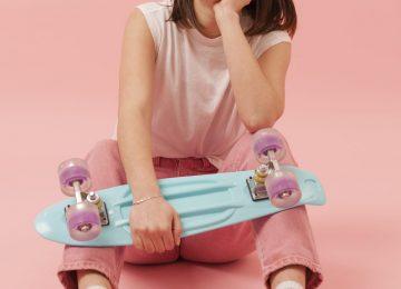 girl-chewing-gum-holding-skateboard