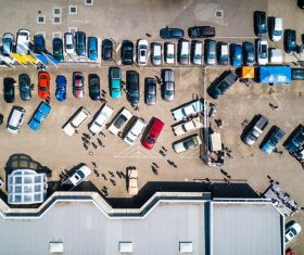 photo-from-above-of-vehicles-parked-near-building-753876