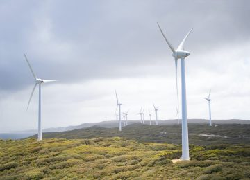 photo-of-wind-turbines-under-cloudy-sky-3619870