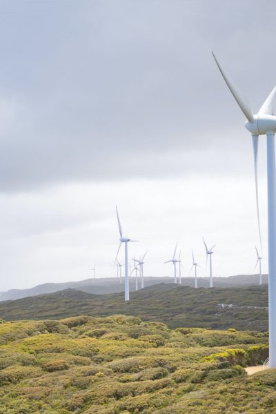photo-of-wind-turbines-under-cloudy-sky-3619870
